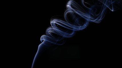 ABSTRACT IMAGE OF SMOKE AGAINST BLACK BACKGROUND