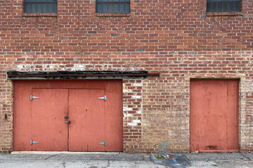 abandoned warehouse alley brick wall red doors