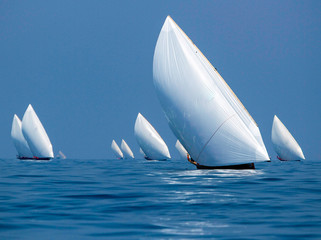 dhow BOATS SAILING IN SEA AGAINST BLUE SKY