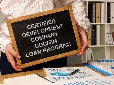 Business photo shows hand written text Certified Development Company CDC/504 Loan Program