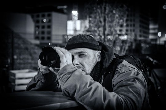 MAN PHOTOGRAPHING IN CITY