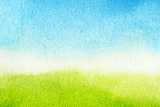 watercolor background is green and blue gradient. Sky with clouds and Green meadow with grass