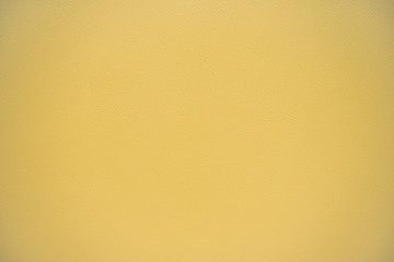 Texture of light yellow brown artificial leather.