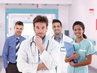 Group portrait of doctors at hospital hallway