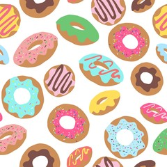Seamless repeat pattern with colourful colorful donuts doughnuts with sprinkles and icing tossed on a white background