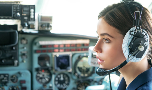 Operatore in avia company persons crew pilots stewardess airplane command civil aviation. Young friendly operator woman agent with headsets working in a avia call centre.