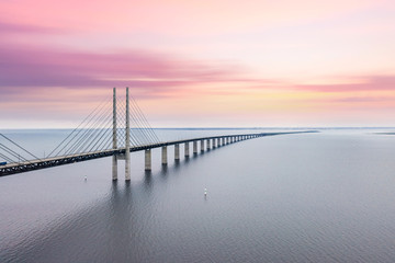 The Oresund bridge between Copenhagen Denmark and Malmo Sweden when sunset in an evening of May