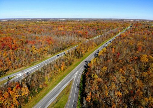 The aerial view of the traffic and stunning fall foliage near Interstate 81 highway of Watertown, New York, U.S.A