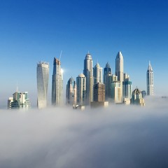 Tuinposter Dubai SKYSCRAPERS IN CITY AGAINST CLEAR SKY