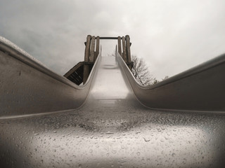 Fototapeta Low Angle View Of Wet Slide Against Sky