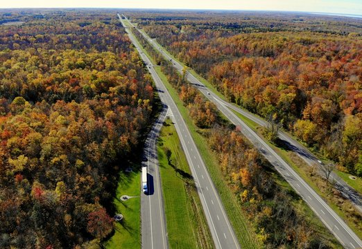 The aerial view of stunning fall foliage and traffic near highway Interstate 81 of Watertown, New York, U.S.A