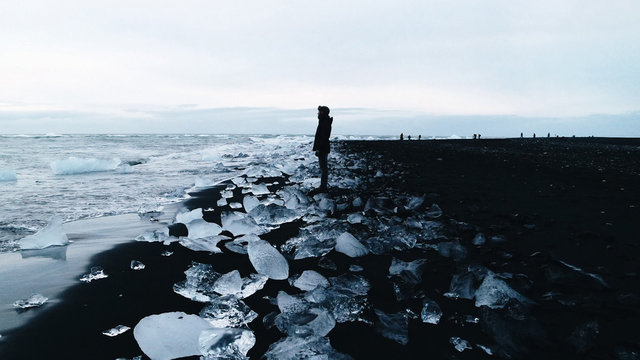 Side View Of Man Standing On Frozen Sea Shore