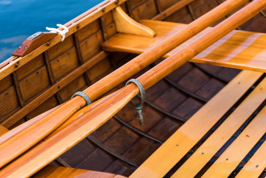 Close-Up Of Wooden Oars In Boat