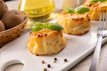 Small casseroles made from potatoes and cheese