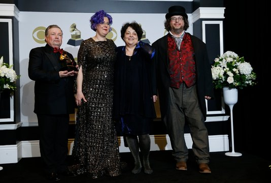 """62nd Grammy Awards – Photo Room – Los Angeles, California, U.S., January 26, 2020 - (lLR): Victor Ledin, Nadia Shpachenko, Marina A. Ledin, and Barry Werger-Gottesman pose backstage with their Best Classical Compendium award for """"The Poetry of Places\"""