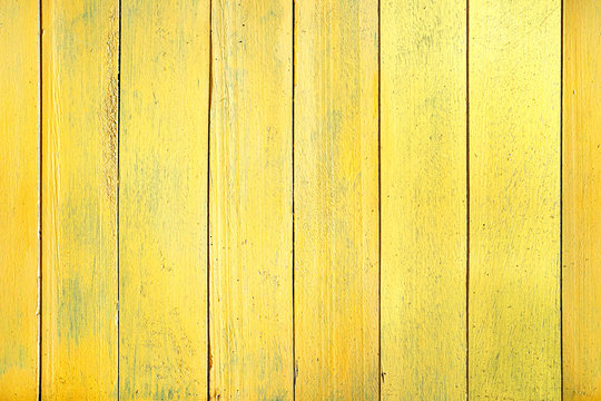 Wood boards texture useful for background. Seamless horizontal texture of wooden planks placed vertically. The uniform color of the wooden fence.