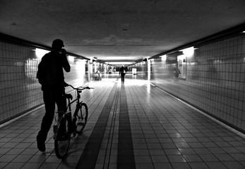 Fototapeta Man With Bicycle Walking In Basement