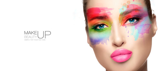 Beauty make up. High fashion model with creative colorful makeup.