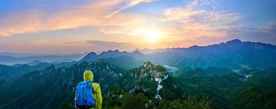 Hiker Looking At Mountains From Great Wall Of China During Sunset