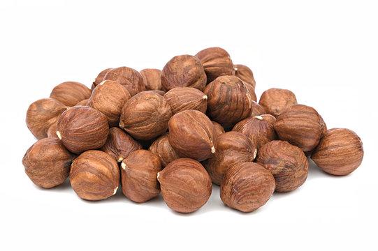 Hazelnut unpeeled isolated white background. Pile of hazelnut closeup. Nuts collection
