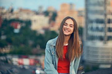 Lovely teen girl on cityscape background Wall mural