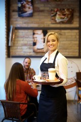 Young waitress smiling happy