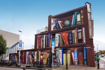 Graffity or painting of a giant bookcase on a house in Utrecht, Netherlands