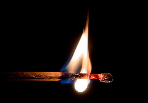 Close-Up Of Burning Matchstick Against Black Background