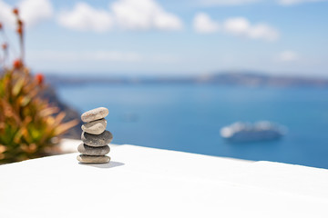 Wall Murals Stones in Sand Zen stones with blue sea background and horizon. Positive thinking and inspirational vibes