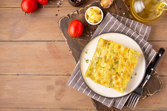 Italian cannelloni pasta with ricotta and spinach, traditional delicious food with cheese