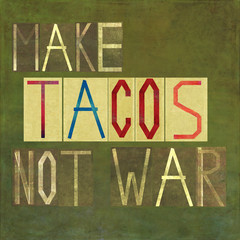 Textured image depicting the words: Make tacos not war
