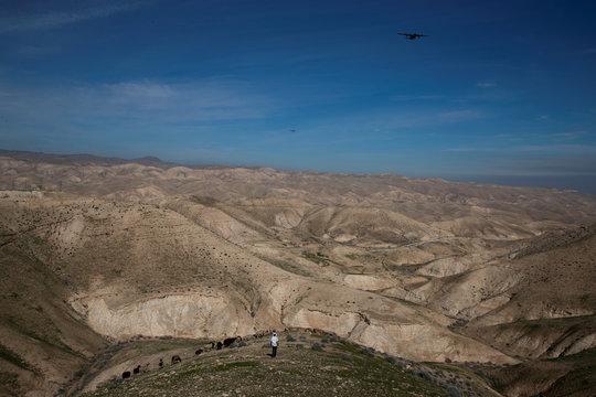 A Jewish shepherd is seen in the landscape near the Israeli settlement of Mitzpe Yericho in the Jordan Valley in the Israeli-occupied West Bank