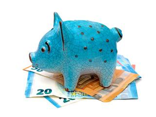 cochon en céramique bleu avec billets de banque