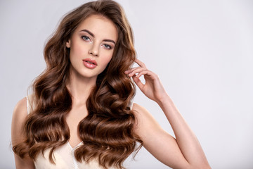 Portrait of a beautiful woman with a long brown hair. Fotobehang