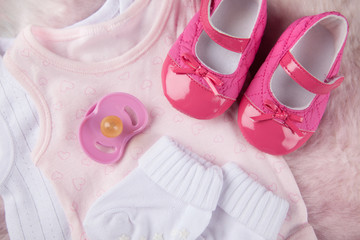 baby girl shoes and pacifier