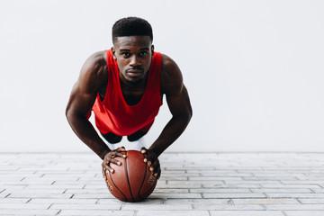 Fototapeta Portrait Of Basketball Player Exercising On Street obraz