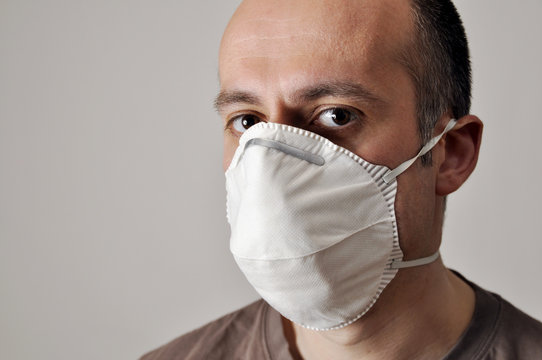 Man with a face mask against infections and viruses such as flu, corona virus, sars or swine influenca
