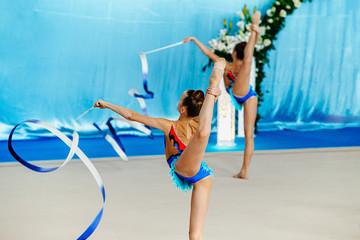 group performance girl gymnasts with ribbon in rhythmic gymnastics