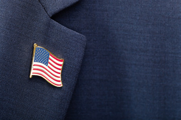 Element of male suit with USA flag pin on chest - studio shot