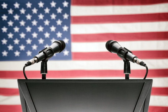 Pulpit with microphones and USA flag on background