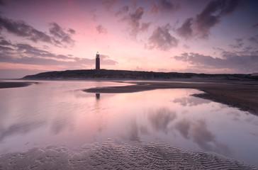beautiful dawn over North sea coast and lighthouse