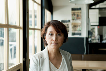 Portrait of mature woman in coffee shop