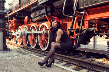 Young girl at the retro train station