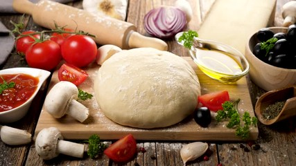 Fotobehang - raw dough pizza on board with ingredient