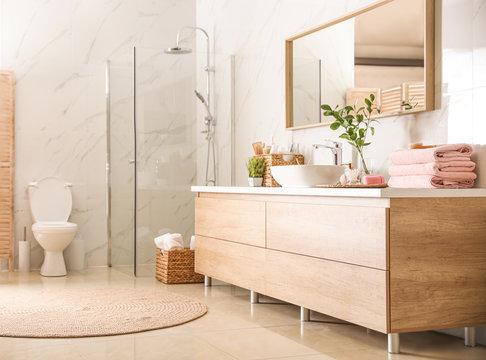 Interior of stylish bathroom with shower unit