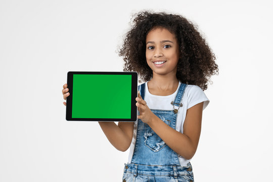 Happy child with tablet isolated on white background