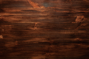 Background texture of old dark brown wood with defects