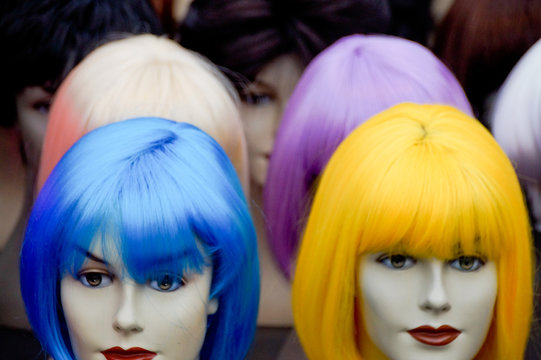 Colorful Wigs On Mannequin At Store