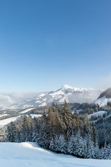 Winter view of the Kitzbuhel Alps in Austria with a clear blue sky