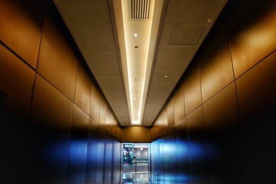 Illuminated Corridor Amidst Wall